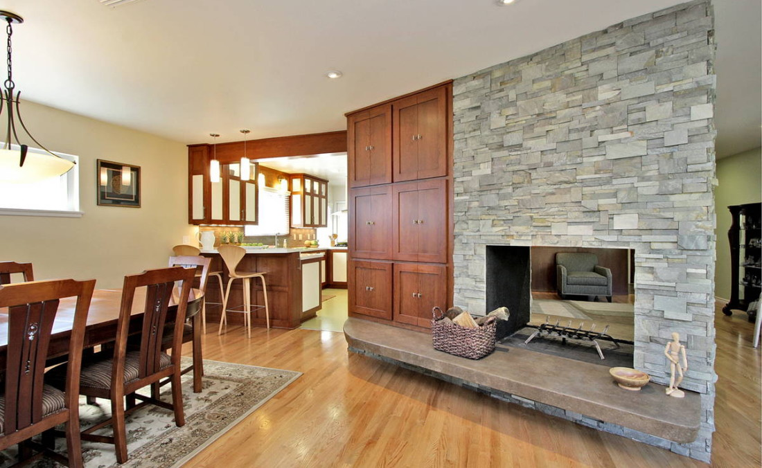 Stacked Stone Fireplace with Floating Concrete Hearth