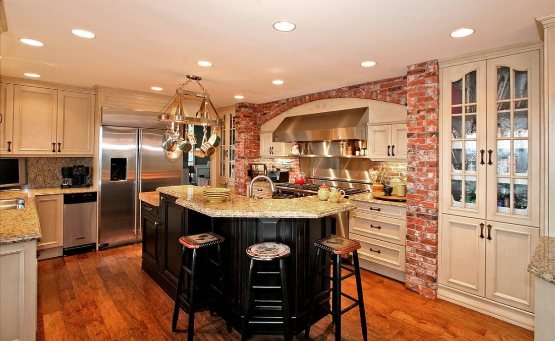 French Country Kitchen Painted and Glazed Cabinetry with Brick Surround