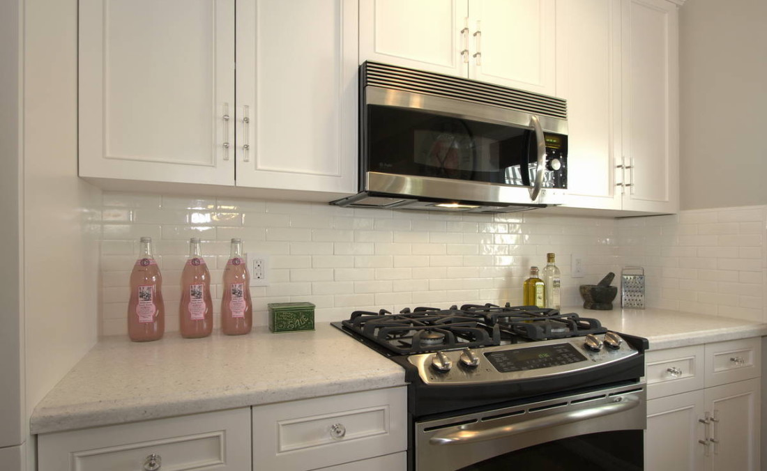 White Cabinetry with Lucite Pulls